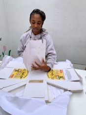 Preparing boxes for fruit cake to sell
